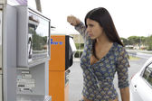 Woman willing to punch gas station — Stock Photo