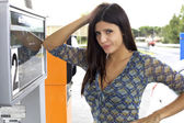 Woman worried about price of gas at gasoline station — Stock Photo