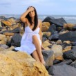 Model posing on rocks in front of sea — Stock Video
