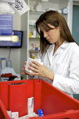 Pharmacist woman at work — Stock Photo