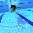 Beautiful swimmer underwater — Wideo stockowe #28496271