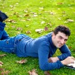 Happy man with tablet in park — Foto Stock