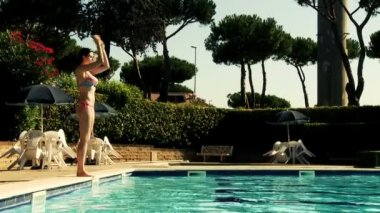 Model jumping into swimming pool — Wideo stockowe
