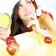 Stock Photo: Beautiful female santa claus thinking about Christmas with highlights