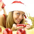 Stock Photo: Happy Santa Claus with little package in hand