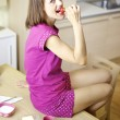 Happy woman eating strawberry for breakfast — Stock Photo #38845019