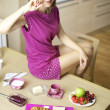 Woman in the morning happy about good continental breakfast — Stock Photo