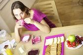 Woman drinking coffee for breakfast — Stock Photo