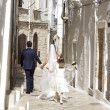 Married couple after wedding in south of italy village with little girl — Stock Photo