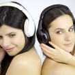 Beautiful women listening music naked — Stock Photo