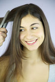 Woman very happy about getting hair done and ironed — Stock Photo
