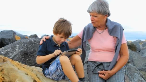 внук с бабушкой на пляже