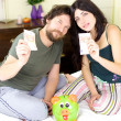 Beautiful couple showing money from piggy bank — Stock Photo #41042041