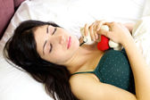 Woman dreaming of boyfriend in love holding plush — Stock Photo
