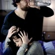 Crazy drunk husband abusing of young wife — Stock Photo #41437147