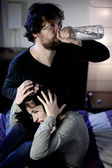 Crazy drunk husband abusing of young wife — Stock Photo