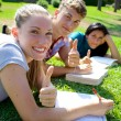 Three happy students thumb up — Stock Photo