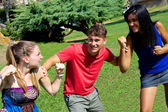 Young man holding two girls fighting for him — Stock Photo