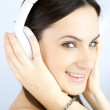 Closeup of woman listening music with headset — Stock Photo #41837037