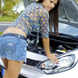 Stock Photo: Gorgeous womwith broken engine worried