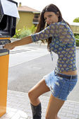 Woman getting money stolen from cash machine — Stock Photo