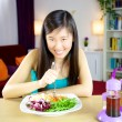 Chinese american girl ready to start diet with salad — Stock Photo