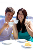 Smiling happy couple in vacation having breakfast in hotel — Stock Photo