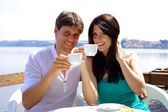 Happy couple having breakfast in vacation in Italy — Stock Photo