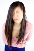 Young asian girl with strong stomach ache — Foto Stock