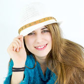 Happy cute female teenager smiling with hat — Stock Photo