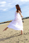 Dancing and posing on the beach — Stock Photo
