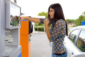 Woman willing to fight the price of gas — Stock Photo