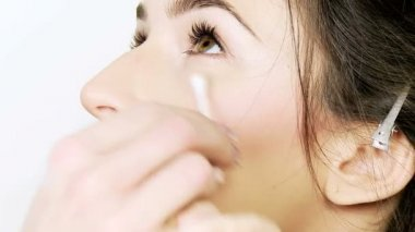 Female model getting makeup — Stock Video