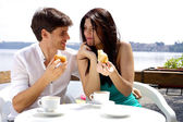 Couple in love having breakfast in front of lake in vacation — Stock Photo