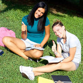 Two female students happy thumb up — Stock Photo