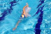 Professional swimmer training in swimming pool — ストック写真