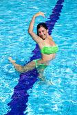 Cute girl playing in the water having fun in swimming pool — Stock Photo