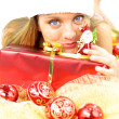 Female Santa Claus playing with little toy of real Santa — Stock Photo #49890837