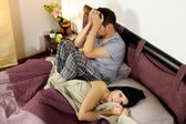 Sad couple after fight in bed — Stock Photo