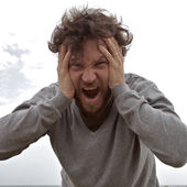 Sad man shouting towards camera — Stock Photo
