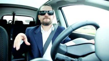 Business man driving car — Stock Video