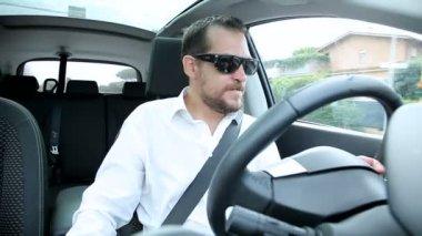 Man taking drug while driving — Stockvideo