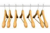 Wooden hangers on rail 1 — Stock Photo