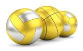 Gold and silver volleyball, basketball and soccerball in row — Stock Photo