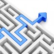 Stock Photo: Blue arrow path across labyrinth