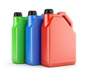 Three colorful plastic canisters — Stock Photo