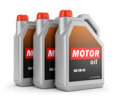 Three cans of motor oil — Stock Photo