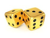 Two golden dices — Stock Photo