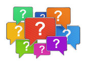 Colorful speech bubbles with question mark symbols — Stock Photo