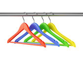 Colorful hangers on clothes rail — Stock Photo